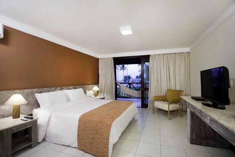 Apartamento Luxo Superior com cama casal e televisão