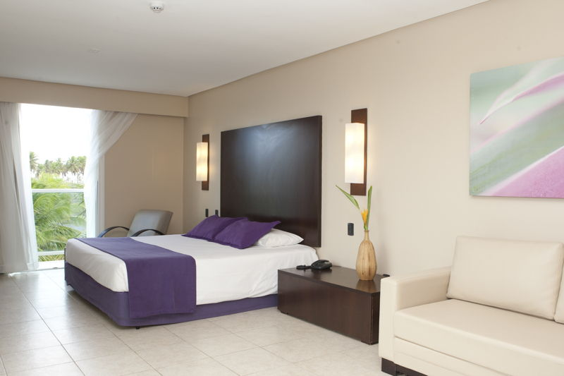 Acomodação Master com cama casal e sofá