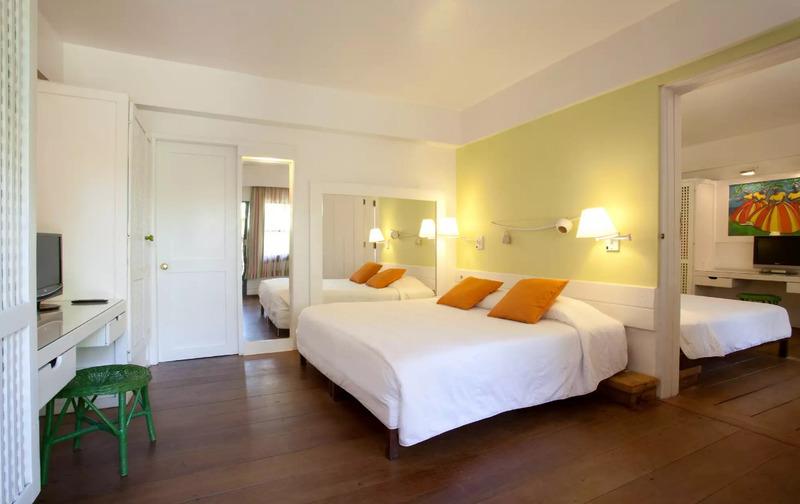 Standard Plus com ambientes interligados e cama casal